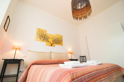 A bed or beds in a room at Bronzino 53