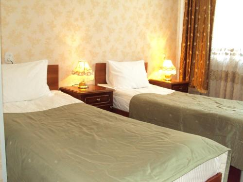 A bed or beds in a room at Hotel Pahra