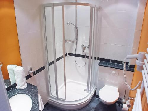 Ein Badezimmer in der Unterkunft Berggasthof Hotel Igelwirt