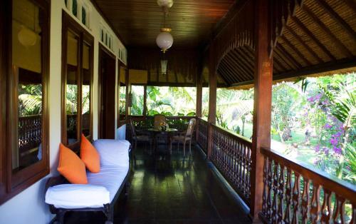 A balcony or terrace at Hotel Tugu Bali