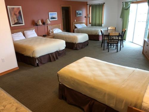 A bed or beds in a room at Longliner Lodge and Suites