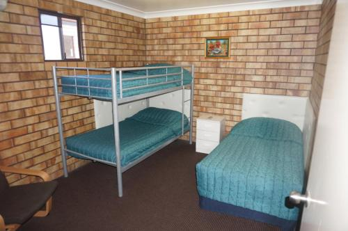 A bunk bed or bunk beds in a room at Miles Outback Motel