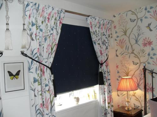 A bed or beds in a room at Jessop House
