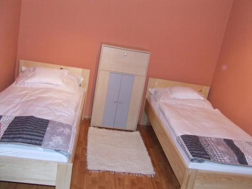 A bed or beds in a room at Nagytabán Vendégház