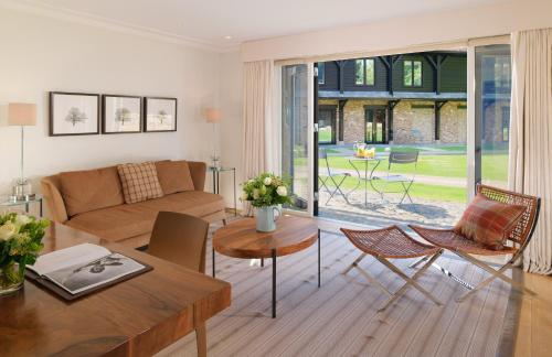 A seating area at Coworth Park - Dorchester Collection