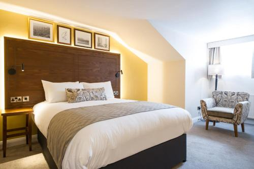 A bed or beds in a room at Innkeeper's Lodge Newcastle, Cramlington
