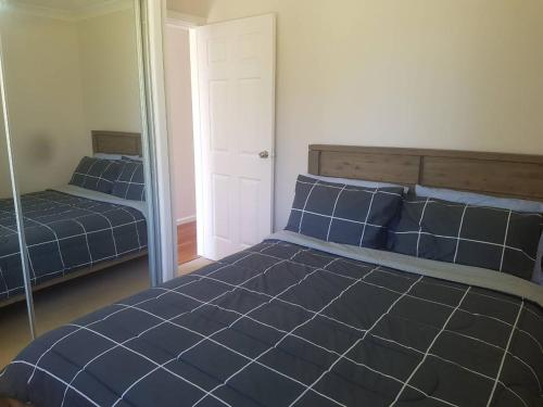 A bed or beds in a room at Escape on Excellence