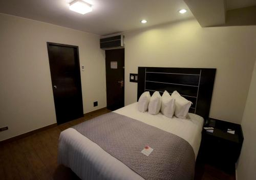 A bed or beds in a room at qp Hotels Arequipa