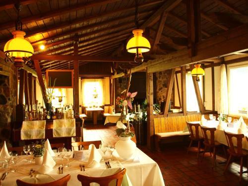 Ein Restaurant oder anderes Speiselokal in der Unterkunft Guggibad Gasthof & Grill