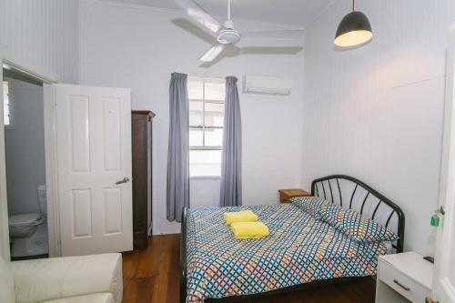 A bed or beds in a room at Ryan's Rest Boutique Accommodation