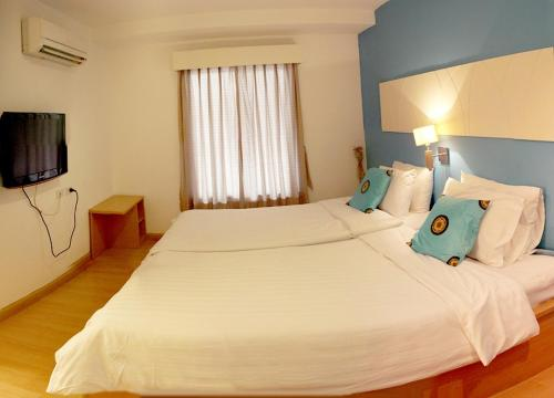 A bed or beds in a room at Nantra de Comfort