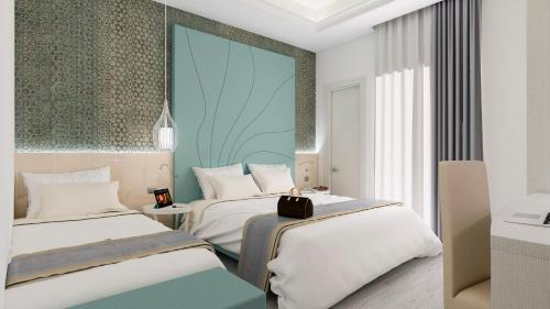 A bed or beds in a room at Hotel Villa Paola