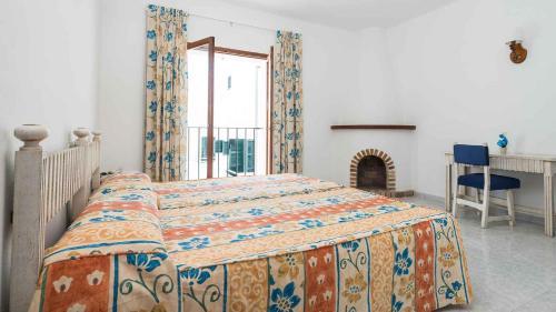 Łóżko lub łóżka w pokoju w obiekcie Hostal San Francisco