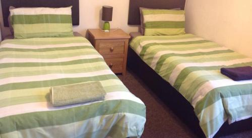 A bed or beds in a room at Albany Guest House