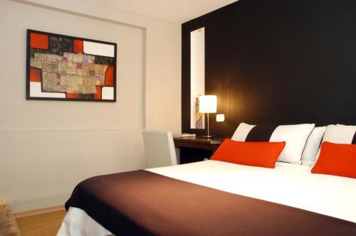 Una cama o camas en una habitación de Bohemia Hotel Boutique