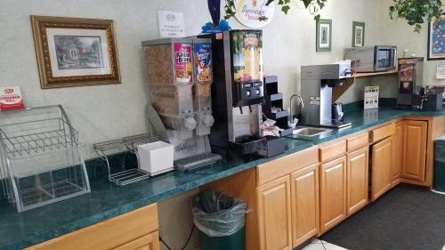 A kitchen or kitchenette at Super 8 by Wyndham Pontoon Beach IL/St. Louis MO Area