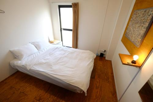 A bed or beds in a room at Scalene Hostel