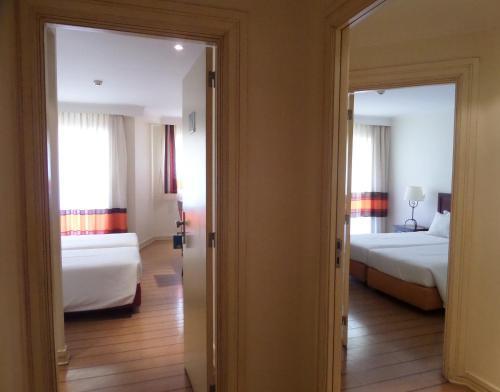 Cama o camas de una habitación en Yellow Alvor Garden - All Inclusive