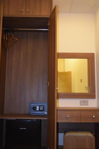 تلفاز و/أو أجهزة ترفيهية في فندق لندن كينغس