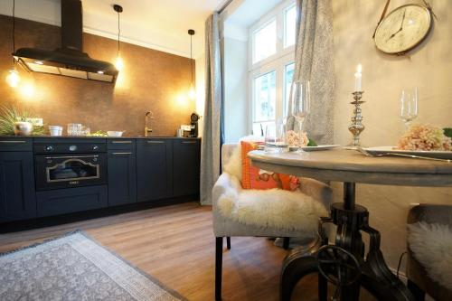 A kitchen or kitchenette at Treveris Suite Relax-Cottage
