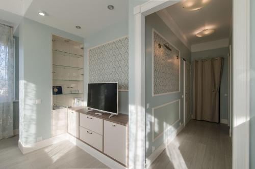 A television and/or entertainment center at Apartment Zima-Leto