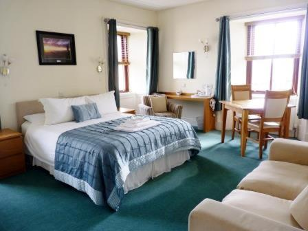A bed or beds in a room at Pentland Lodge House
