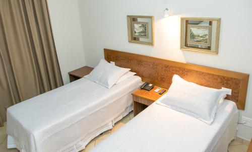 A bed or beds in a room at Reisper Palace Hotel
