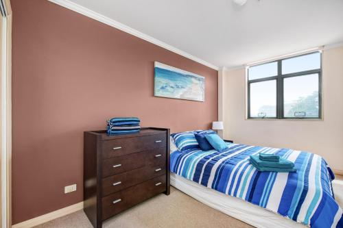 A bed or beds in a room at Fabulous beach apartment