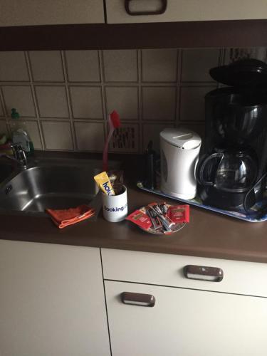 A kitchen or kitchenette at Studio Oostende Budget