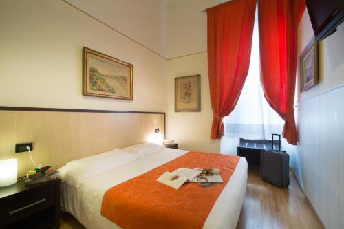 A bed or beds in a room at Tourist House Battistero