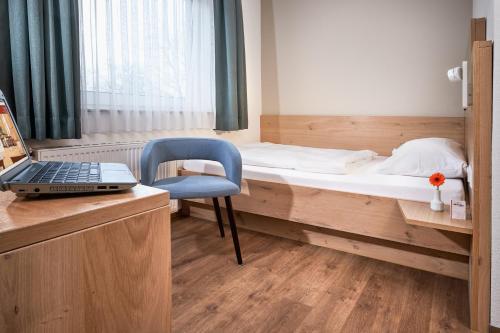 Ein Bett oder Betten in einem Zimmer der Unterkunft Hotel Heuboden