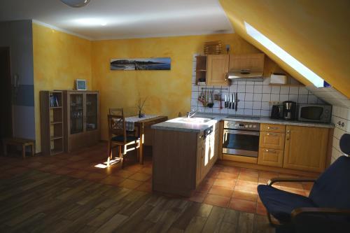 A kitchen or kitchenette at Ferienwohnung Koserow