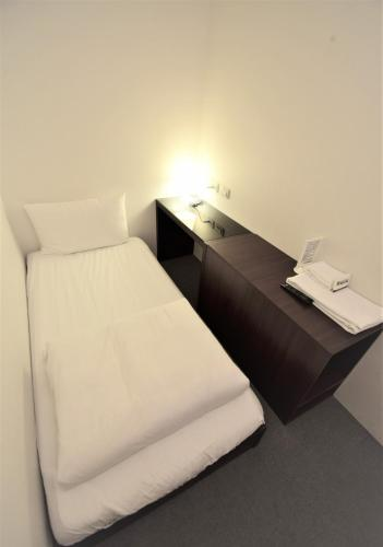 A bed or beds in a room at Inn Cube - Ximen