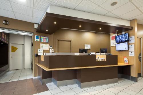 The lobby or reception area at B&B Hôtel Paris Porte de la Villette