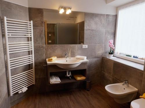 Ein Badezimmer in der Unterkunft Niederhof