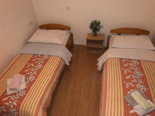 A bed or beds in a room at Vulinka Pension