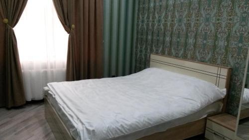 Cama ou camas em um quarto em Bala Kur Lux otel