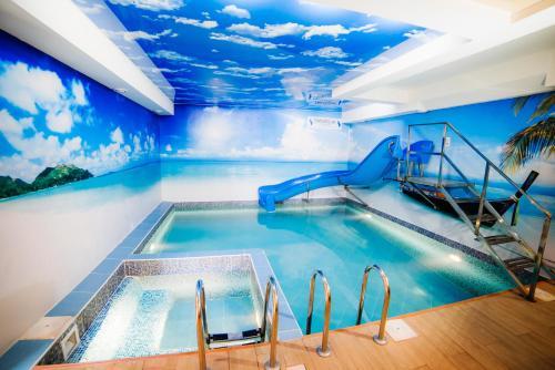 The swimming pool at or near Paradis Inn Hotel & Spa
