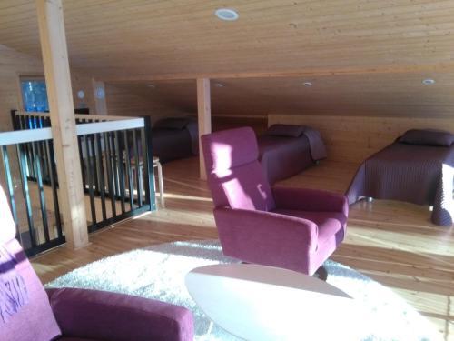 A seating area at Mustikkakallio Luxury Villa