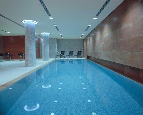 The swimming pool at or close to Radisson Blu Hotel, Berlin