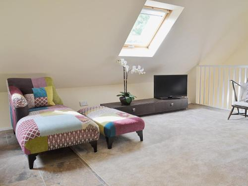 A bed or beds in a room at Forest Cottage