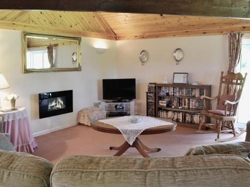 A television and/or entertainment center at Mill End Farm Cott.