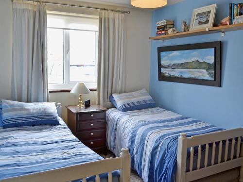 A bed or beds in a room at Seaspray