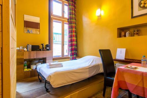 Een bed of bedden in een kamer bij Cornerhouse