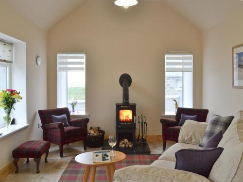 A seating area at Kilbride Beach Cottage