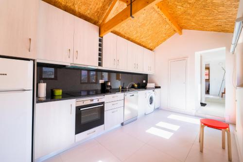 A cozinha ou kitchenette de Aguda Beach Charming House by MP