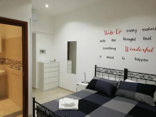 Ένα ή περισσότερα κρεβάτια σε δωμάτιο στο ImeraRooms