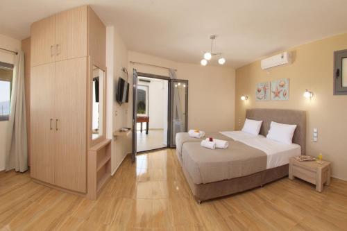 Ένα ή περισσότερα κρεβάτια σε δωμάτιο στο Kefalonia Horizon Villas