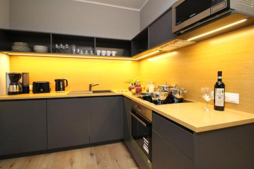 A kitchen or kitchenette at Tallinn City Apartments Old Town Suites