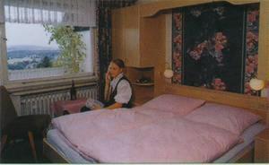 Ein Bett oder Betten in einem Zimmer der Unterkunft Hotel Im Hagen
